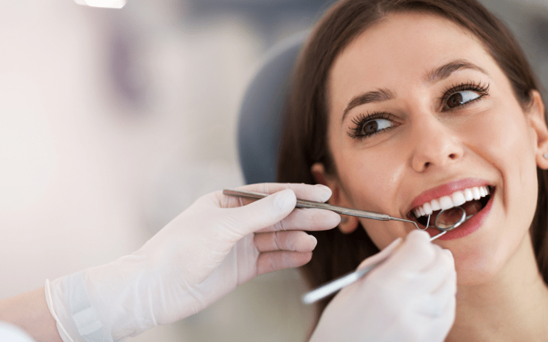 Woman getting her teeth checked at dentist