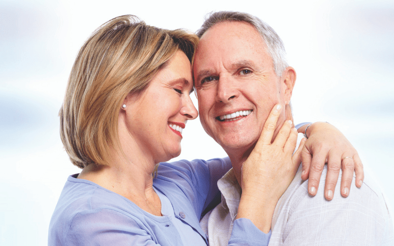 Middle age woman and man embracing