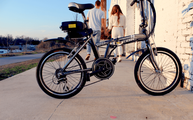 Bike with a couple walking away