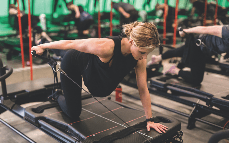 Woman working out on a megaformer