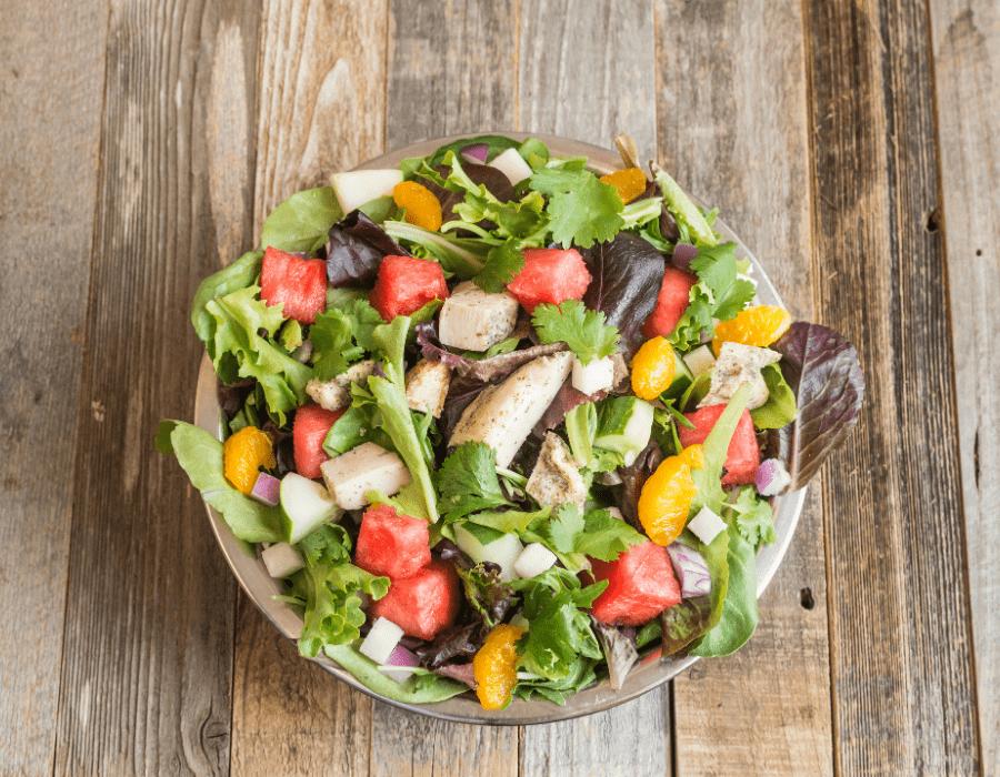 Salata Watermelon Salad on wooden table