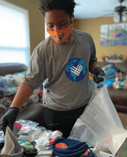 CJ Matthews packs care bags