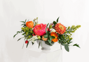 Colorful bouquet with pink and orange flowers with greenery