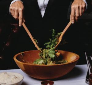 Man mixing a salad