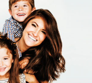 two pretty children kissing their mother happy smiling close up, happy family, brother and sister, lifestyle real people concept