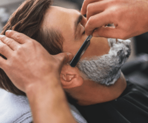 Men getting his beard trimmed up