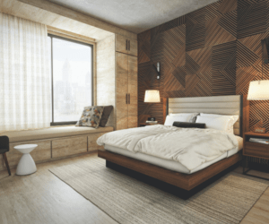 A hotel room at Bellyard with wooden backdrop and white bed