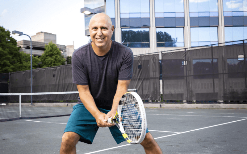 Richie Shapiro gets set for a tennis match