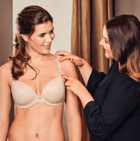 Woman getting fitted for a bra