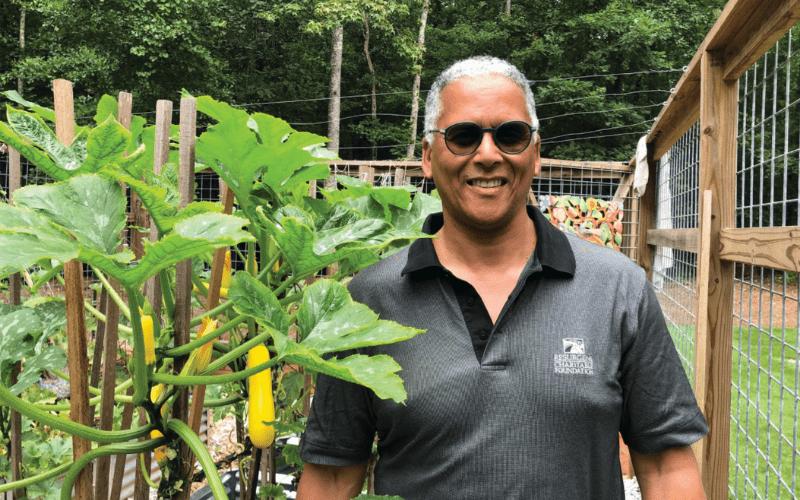Robert Greenfield, M.D. in front of his garden