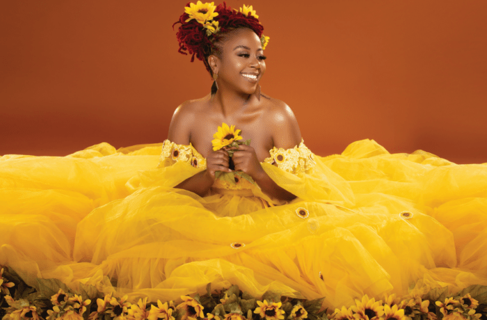 Pinky Cole with Sunflowers by Drea Nicole Photography